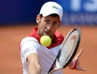 Djokovic in surprise Barcelona defeat, no sweat for Nadal