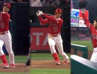 Ohtani hits homer, leaves game with sprained ankle