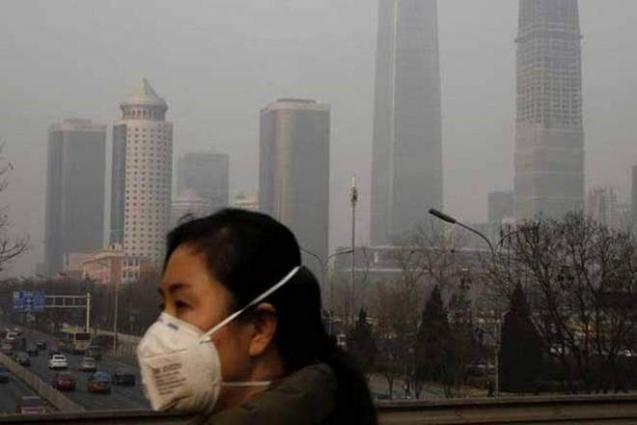 Beijing issues yellow alert for air pollution