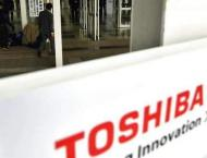 Struggling Toshiba returns to black, avoids delisting