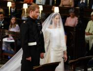 Harry and Meghan hold hands at emotional wedding service
