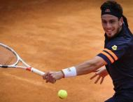 Briton Norrie upsets Isner as seeds continue to fall in Lyon