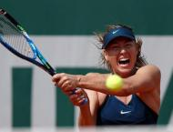 Sharapova edges closer to French Open duel with catsuit Serena