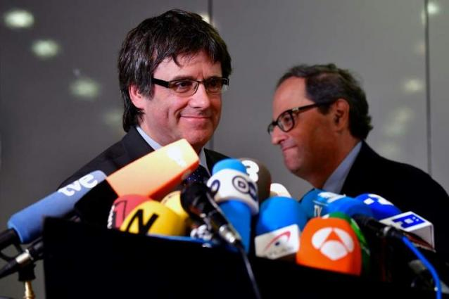 New Catalan leader asks to meet Spain PM, 'xenophobia' row grows