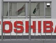 Toshiba completes $21 bn sale of chip unit