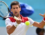 Djokovic cruises at Queen's, Murray set to return