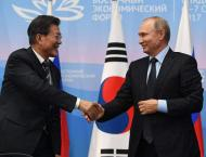 S. Korea's Moon arrives in Russia for talks with Putin