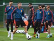 Spain, Portugal target last 16 as Russia ride momentum