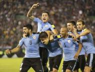 Uruguay top World Cup Group A, Russia second after 3-0 defeat