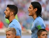 Uruguay top World Cup group as Spain, Portugal target knockouts