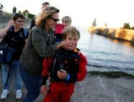 Schoolboy, 12, gets hug from mum after record Channel sail