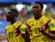 Mina winner sends Colombia through as ill-disciplined Senegal go  ..