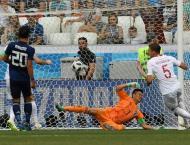 Japan booed off but reach last 16 despite Poland loss