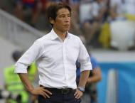 Japan coach 'forced' to tell team to back off