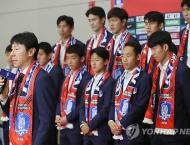 S. Korean World Cup team returns to warm welcome after shock win  ..