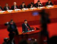 "China honors grassroots Party chief as ""role model"""