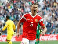 Journeyman Dzyuba wins Russian hearts at World Cup