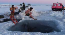 Antarctic researchers mark winter solstice with icy plunge