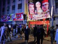 AP: Pakistani Taliban claim bombing at rally that killed 21