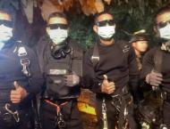 "Thai boys were passed ""sleeping"" through cave: rescue diver"