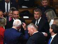Czech government wins confidence vote backed by Communists