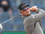 Former champion Johnson surges at British Open, McIlroy closes on ..