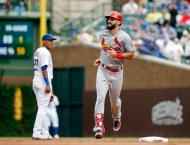 Cards' Carpenter erupts for historic three homers, two doubles