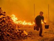 California scorched by raging wildfires the size of LA