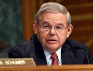 US Senator Menendez Says Troubled By Trump Not Standing Up to Rus ..