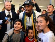 sain Bolt arrives in Australia on football quest