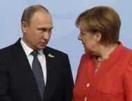 Putin, Merkel Say Iran Nuclear Deal Must Be Preserved
