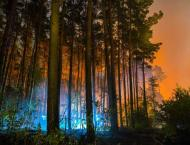 German firefighters stop spread of huge blaze, warn of ongoing th ..