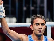 India's Amit stuns Olympic champion, Uzbeks lords of Asian ring