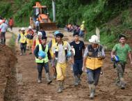 Dozens buried in Philippine landslide as China counts cost of Typ ..