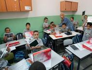 Turkish aid agency distributes android tablets in Palestine