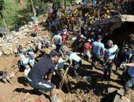 Grim search for typhoon landslide victims as Philippines toll cli ..
