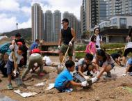 Hong Kong comes together for massive typhoon clean-up