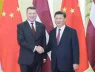 Xi meets Latvian president