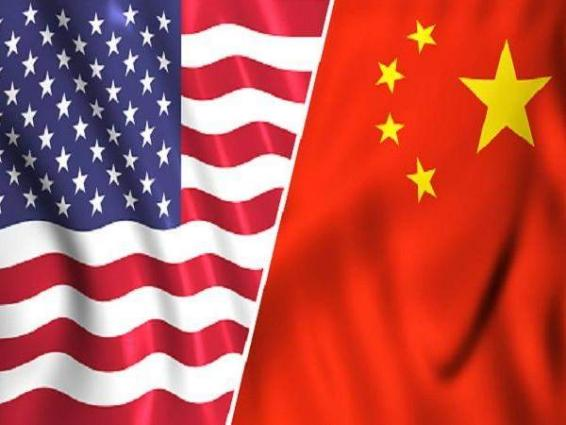 China warns of protectionism as US trade row simmers