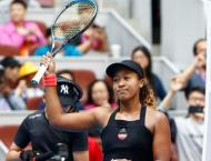Quickfire Osaka charges into Beijing last eight