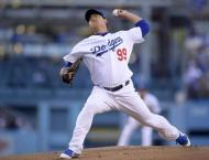 Ryu powers Dodgers past Braves to win NL series opener