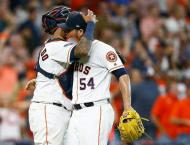 Astros belt four home runs, beat Indians in playoff opener