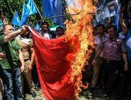 Malaysia frees 11 Uighurs, defying China handover request