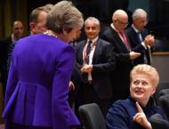 UK PM mulls longer transition as EU demands Brexit progress