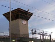 At Guantanamo, prisoners watch parade of US military guards go by ..