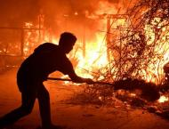 Nine die in California wildfires, hundreds of thousands forced to ..