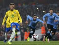 Neymar penalty punishes Uruguay in feisty friendly