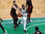 Celtics edge Raptors in overtime battle of Eastern powers