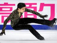 Two-time Olympic champion Hanyu survives fall to win in Moscow