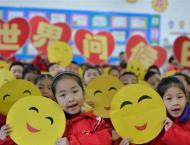 Chinese cities light up for World Children's Day
